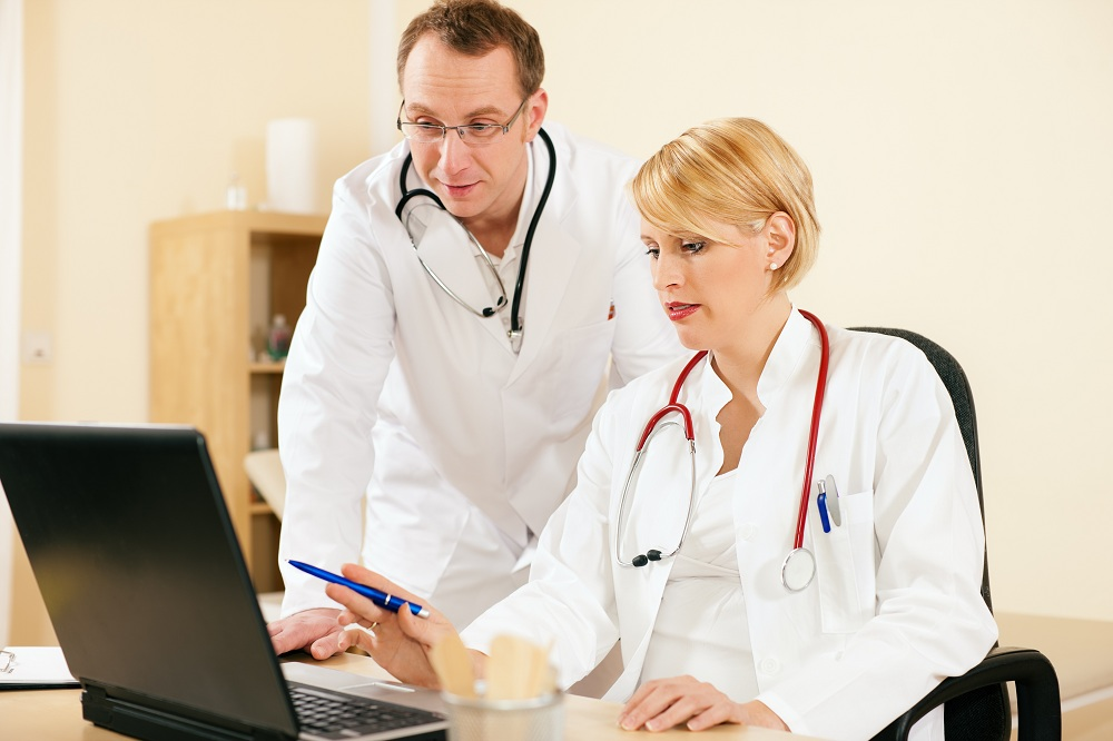 doctors looking at the computer