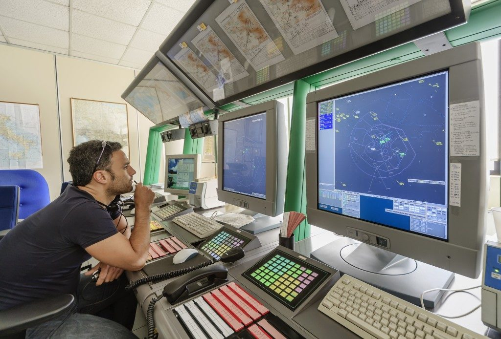Man working at a flight control tower