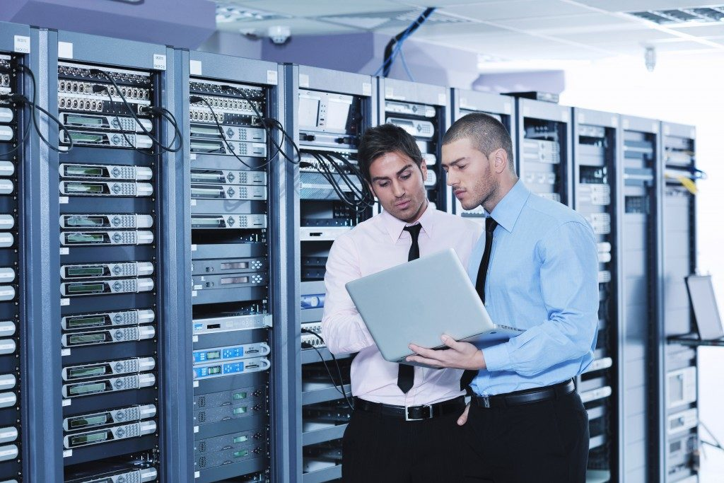 IT personnel securing data backup
