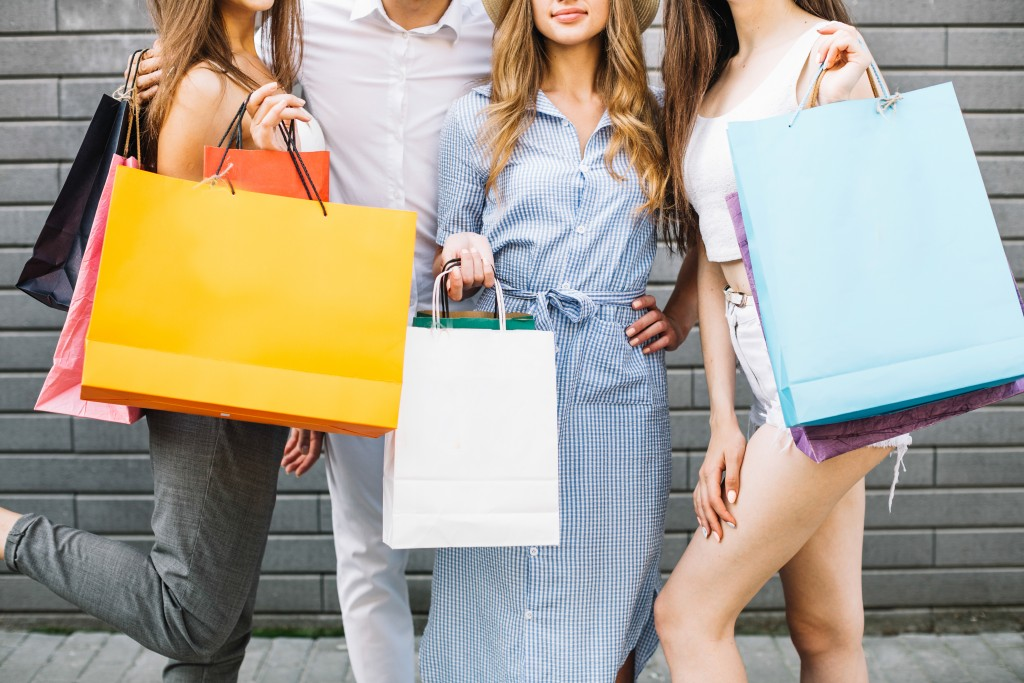 customers with shopping bags